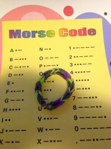 Photo of Morse Code chart and a completed Rainbow Loom bracelet